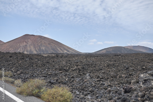 Spoed Foto op Canvas Canarische Eilanden Lanzarote, Spain - August 21, 2015 : View of Montana Bermeja, Lanzarote