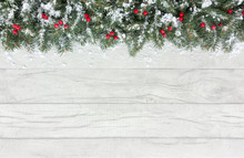 Christmas Border With Snow Covered Red Berries And Fir