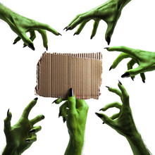 Halloween Green Witches Or Zombie Monster Hand Holding A Blank Sign