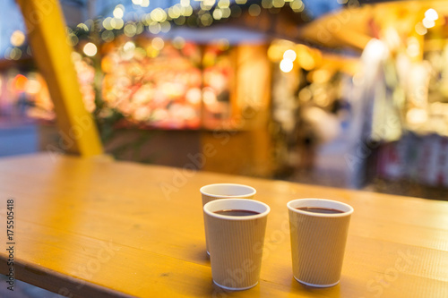 Spoed Foto op Canvas Chocolade mulled wine in paper cups at christmas market