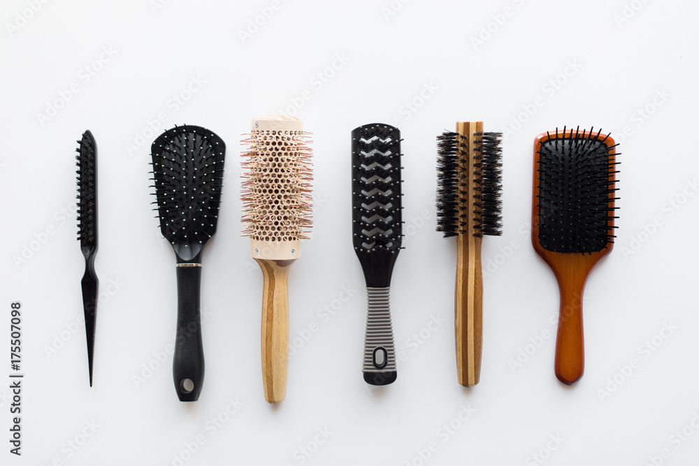 Fototapeta different hair brushes or combs from top
