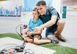 Father teaches his son to design complex robots and electronic devices, the concept of education and family