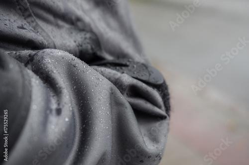 Fotografiet  Waterproof jacket with rain drops