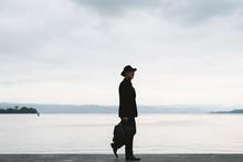 Gentleman Walking Against The ...