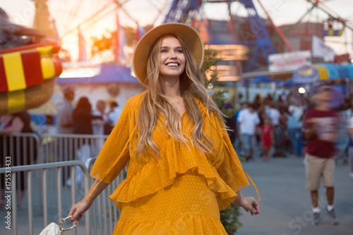 Poster Attraction parc Beautiful happy young woman enjoy the time in amusement park and rides