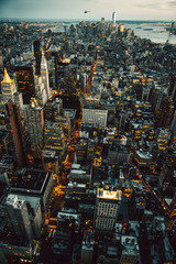 Panel Szklany Manhattan New York City buildings lights aerial top view at the night time