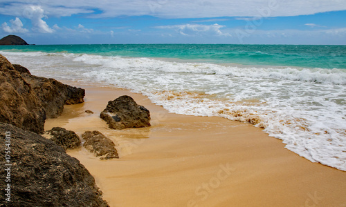 Seascape of rocks and approaching waves at Bellows Beach, Oahu, Hawaii