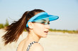 Closeup portrait of a young girl in blue visor