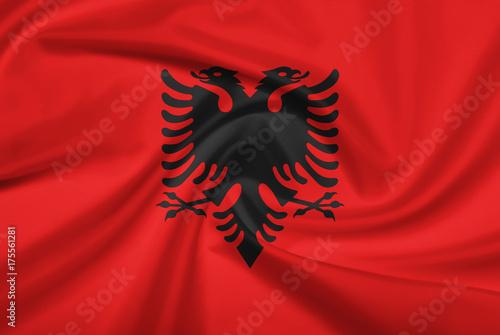 Plakat Flaga Albanii z tkaniny tekstury.