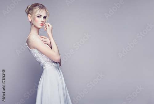 Fotografie, Obraz  Fashion portrait of Beautiful Young Woman with Blond Hair