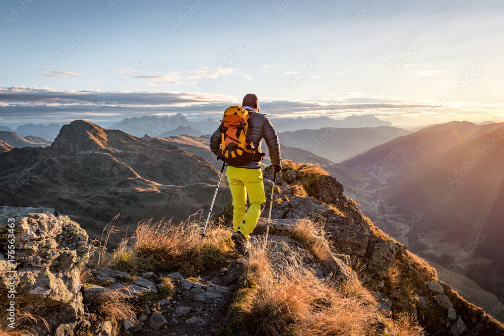 Fototapety, obrazy: Mountaineer hiking in the mountains in morning light