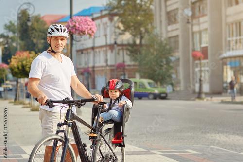 Deurstickers Fiets Cheerful family biking in park