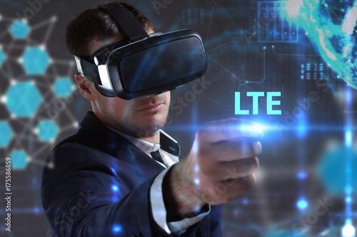 Deurstickers Surrealisme Business, Technology, Internet and network concept. Young businessman working in virtual reality glasses sees the inscription: LTE