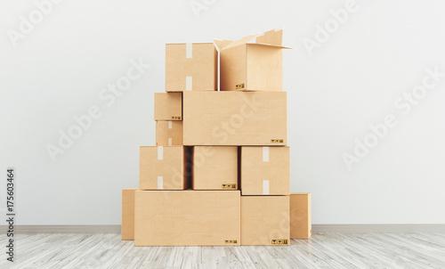 Scatoloni di cartone in pila sul pavimento, trasloco Fototapet