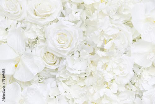 Foto op Canvas Bloemen Decoration artificial white roses flower bouquet as a floral wallpaper with soft focus and copy space. White rose and orchid petals background for valentines day or wedding ceremony.