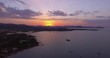 Aerial, beautiful bay in Sardinia with the view on Tavolara island on sunset, 4K