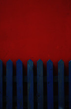 Blue Fence On Red Wall