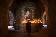 Young Novice Monk Praying With...