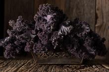 Purple Kale In Rustic Setting