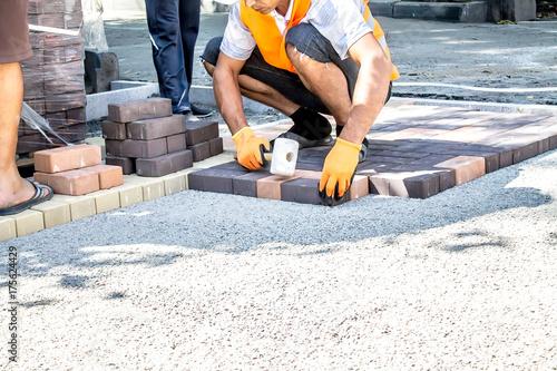 Fotografie, Obraz Work on laying paving slabs