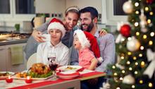 Smiling Family Taking Selfie For Christmas.
