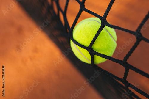 Fotografering  Tennis ball hitting the tennis net
