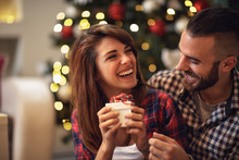 Couple With Gift Together On Christmas Eve