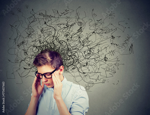 Thoughtful stressed young man with a mess in his head Canvas Print