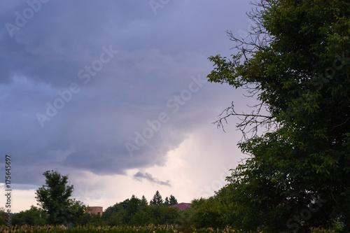Photo  Evening storm clouds over the village landscape.