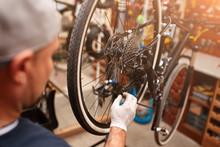 Mechanic Repairing Bicycle In ...