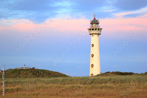 Foto auf Leinwand Leuchtturm Lighthouse at sunset in the twilight. Egmond aan Zee, North Sea, the Netherlands.