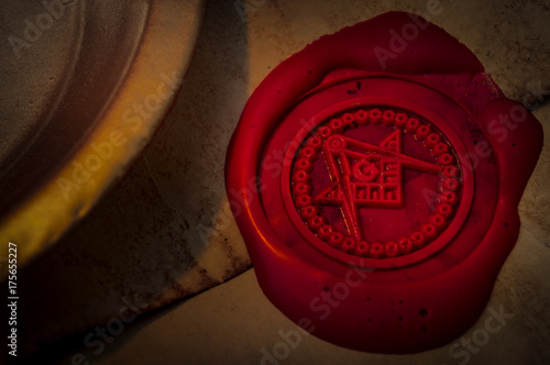 Fotografija Freemason secret symbol concept with vintage letter under a candle, sealed with