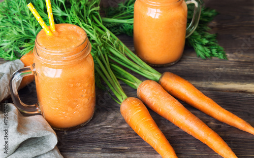 Fresh carrot smoothie in jars