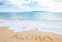 The Word Aloha Written In Sand...