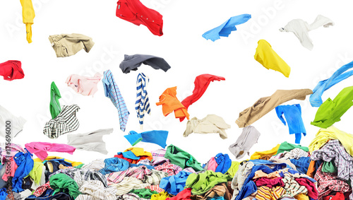 Fotografía  Separate clothing falling at the big pile of clothes on a white background