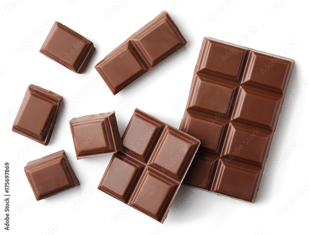 Milk chocolate pieces isolated on white background
