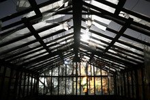 A Horror Scene Of Damaged, Old, Scary And Abandoned Greenhouse In Night Of Full Moon. Darkness And Shadows Are Causing Goosebumps And Fear. Wind And Storm Has Torn The Plastic Sheeting And Glass