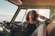 Woman on road trip taking rest in the van