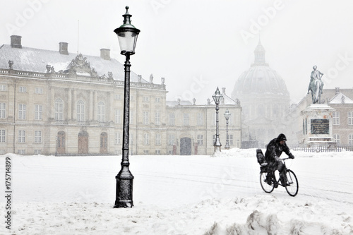 Man on bicycle in winter time Poster