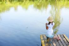 Little Girl Fishing In River