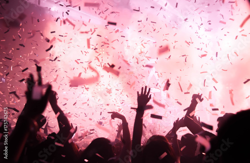 Silhouette hands of audience crowd people use smart phones enjoying the club party with concert. Celebrate new year party , Blurry night club party people enjoy . Concert new year party.