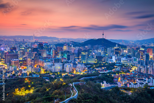 Photo Stands Asian Famous Place Seoul. Cityscape image of Seoul downtown during summer sunrise.