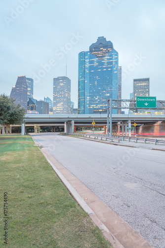 Foto op Canvas Oceanië Downtown Houston from Allen Parkway near Sabine street at blue hour. Highway/expressway in front of skyscrapers from central business district. Transportation, architecture and travel concept