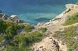 Coastline on small Greek island Telendos. Beautiful blue sea and green bushes. Pure nature landscape in Greece.