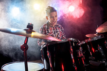 Drummer Playing The Drums With...