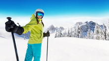 Happy Young Woman Skier Enjoying Sunny Weather In Alps