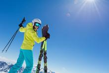 Happy Young Woman Skier Enjoyi...