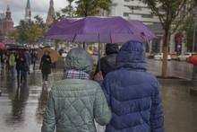 People Walk Under An Umbrella ...