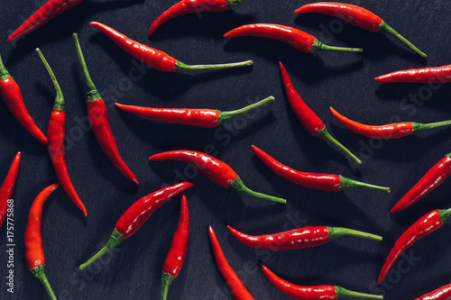 Red chili pepper on slate plate.The view from the top