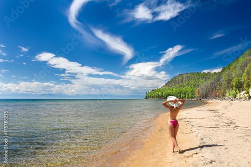 A girl on a sandy beach on a lake baikal Wallpaper Mural